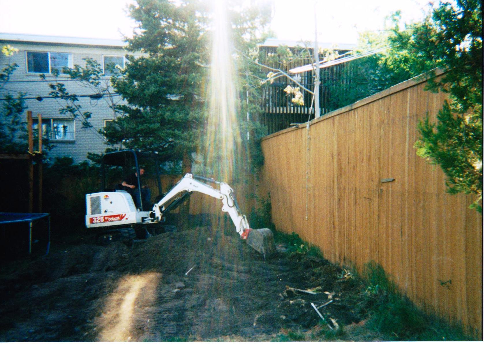 Backyard being set for basketball court.jpg