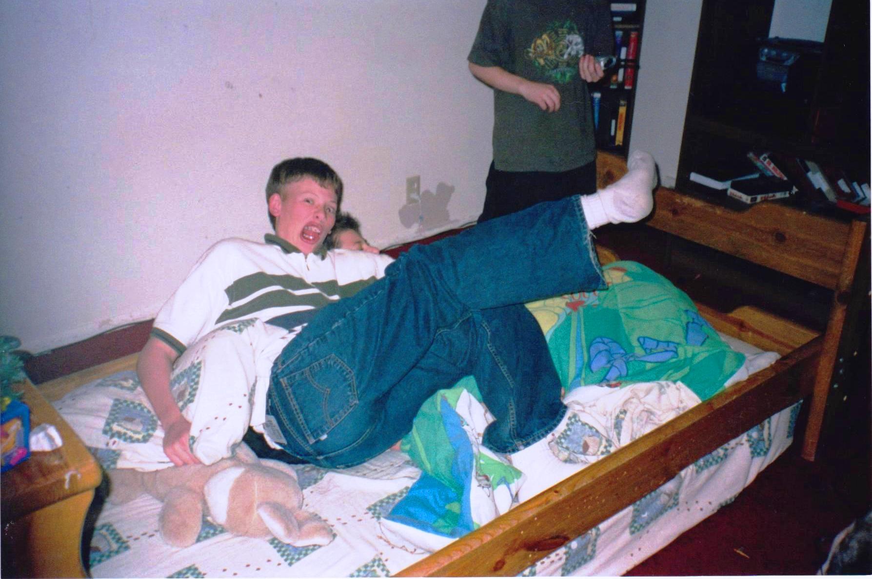 Brett clobering me on Christmas 99.jpg