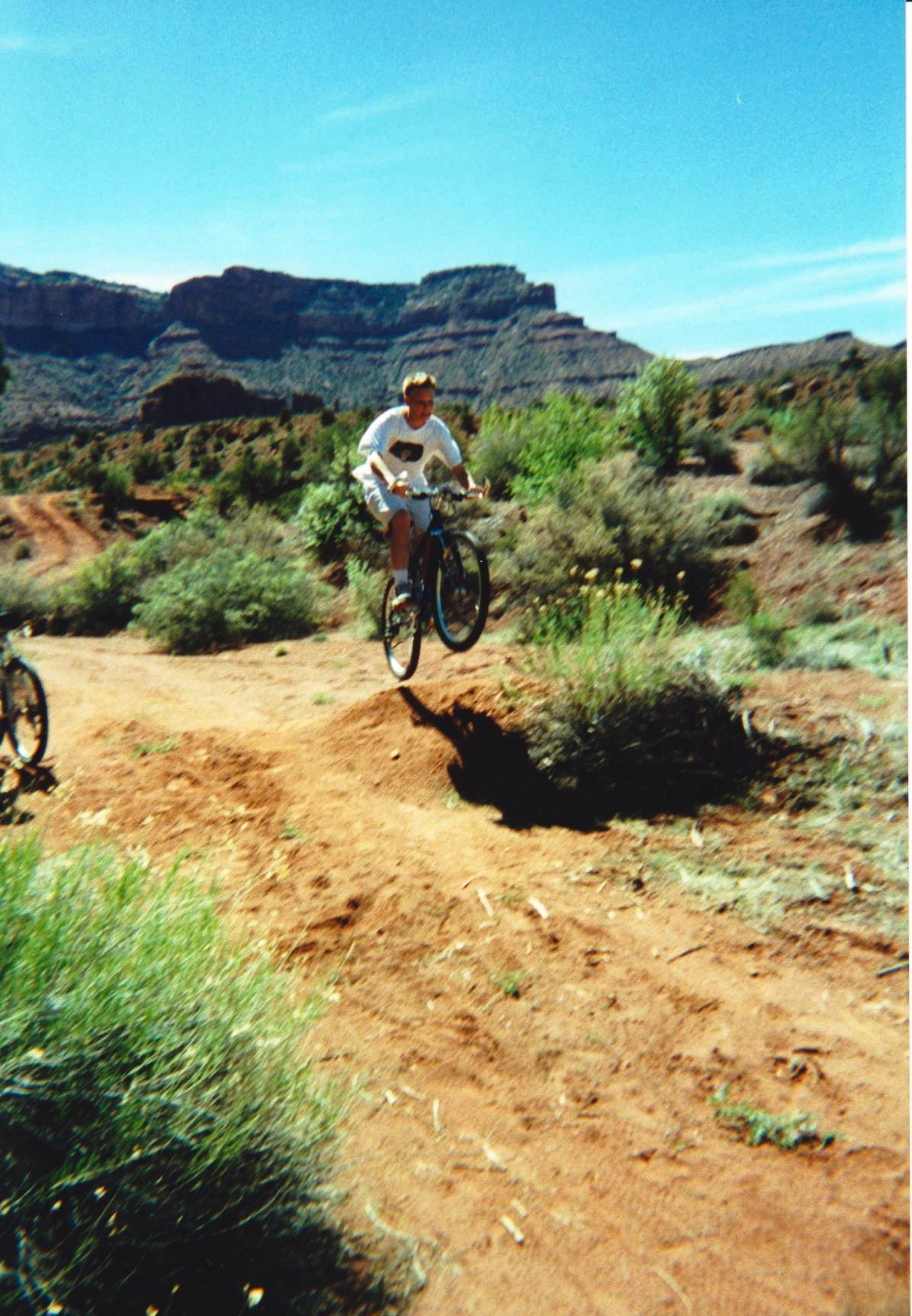 Brett jumping off bike ramp in Moab.jpg