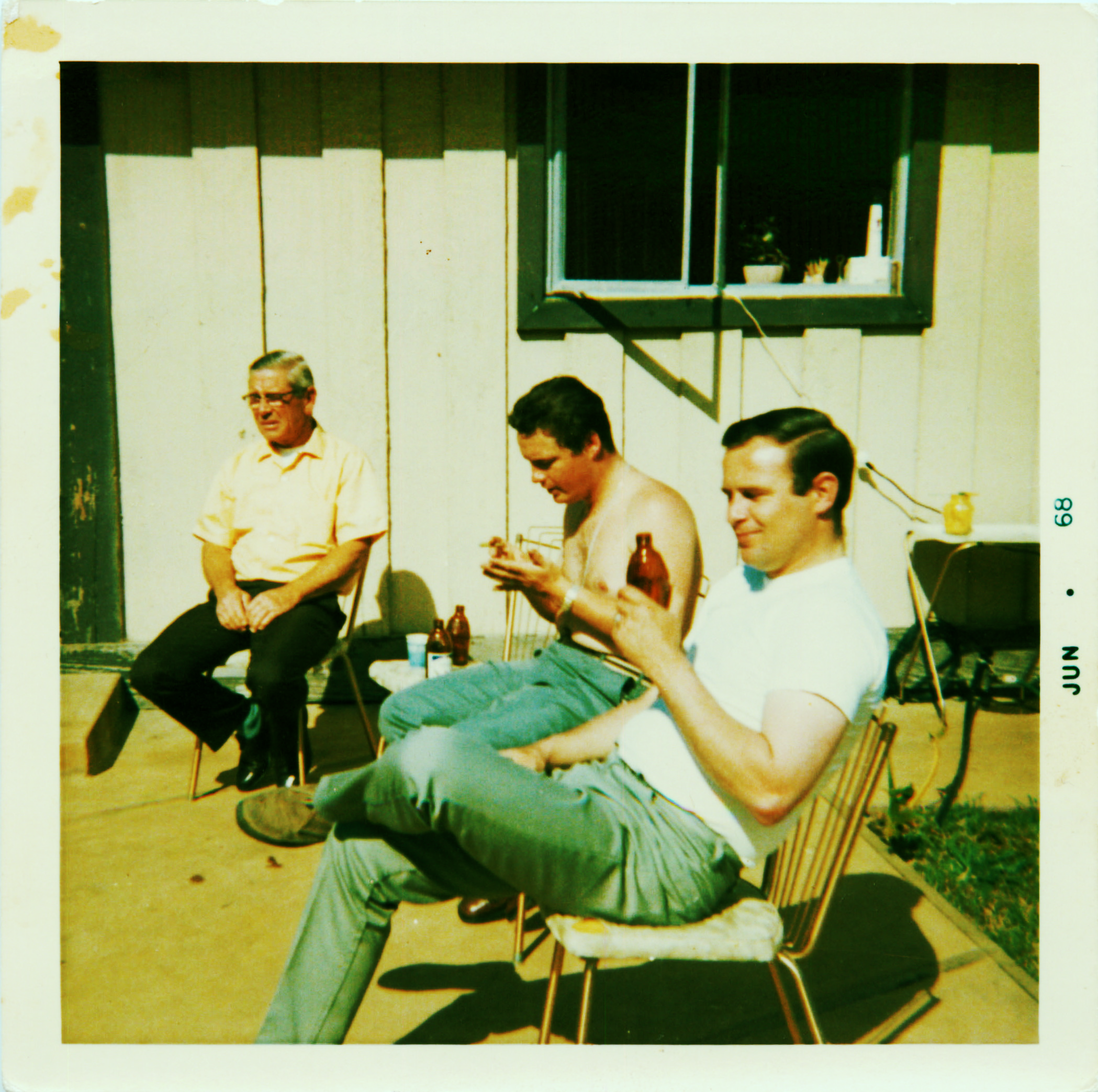 My father (middle) and his cousin Donny (right) outside on a sunny day in Pacifica having a beer with my Grandpa Elmo.