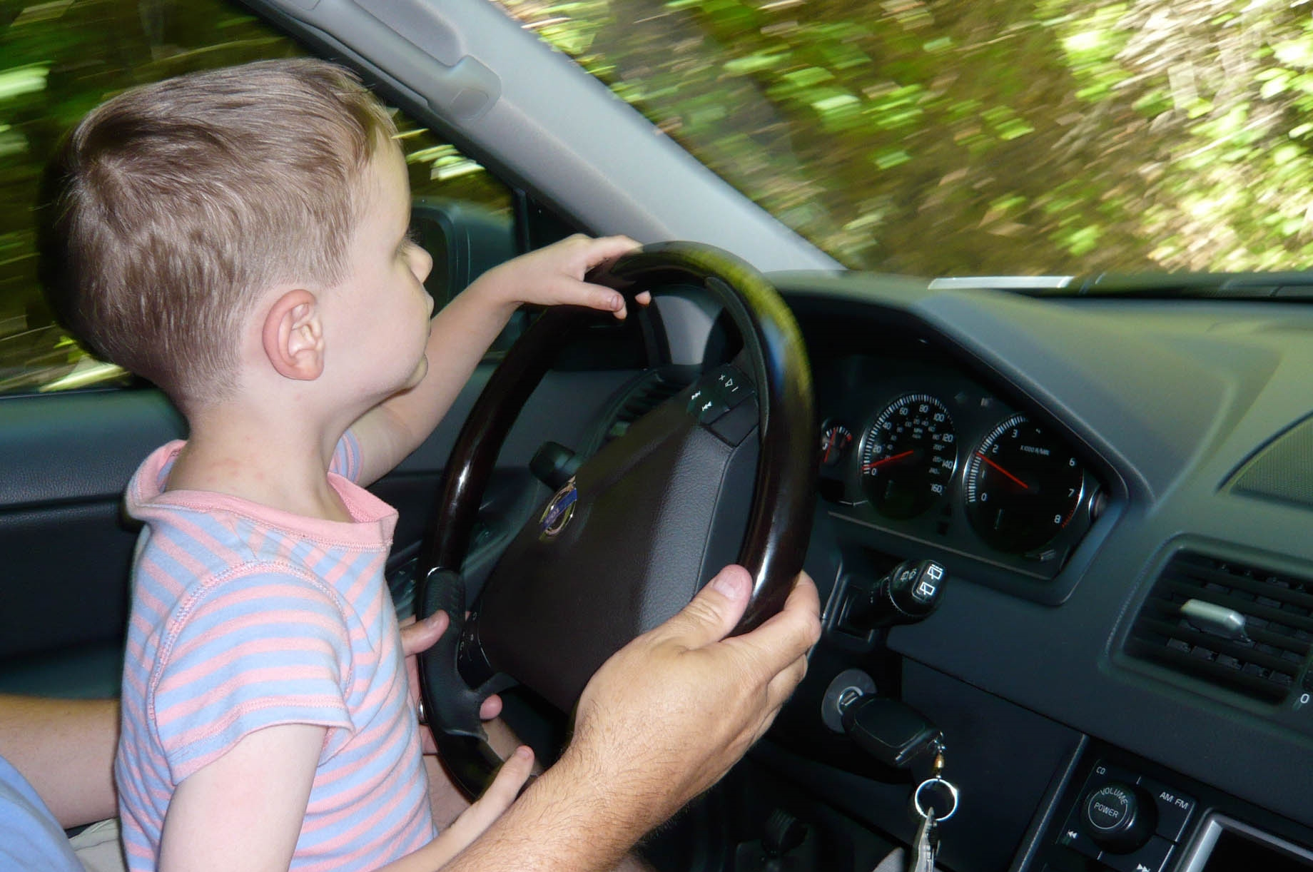 Josh driving the cabin road.