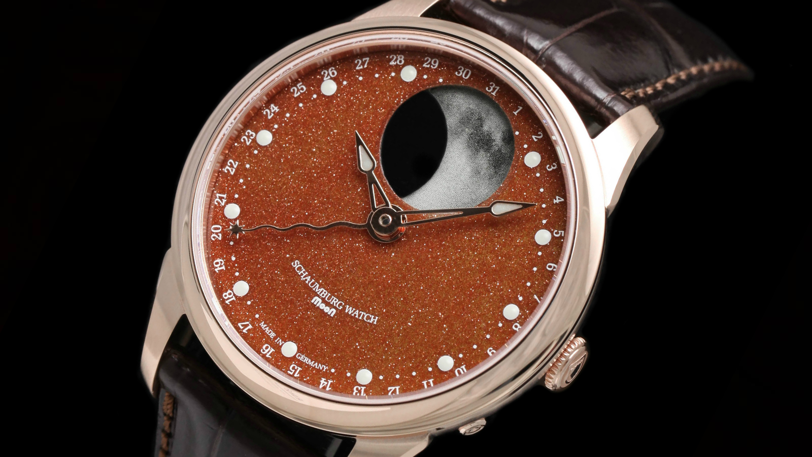 Schaumburg Watch Perpetual MooN Galaxy 18Kt rose gold watch with copper goldstone dial and luminous moon phase by Chronolux Fine Watches, Authorised dealer for Schaumburg Watch.