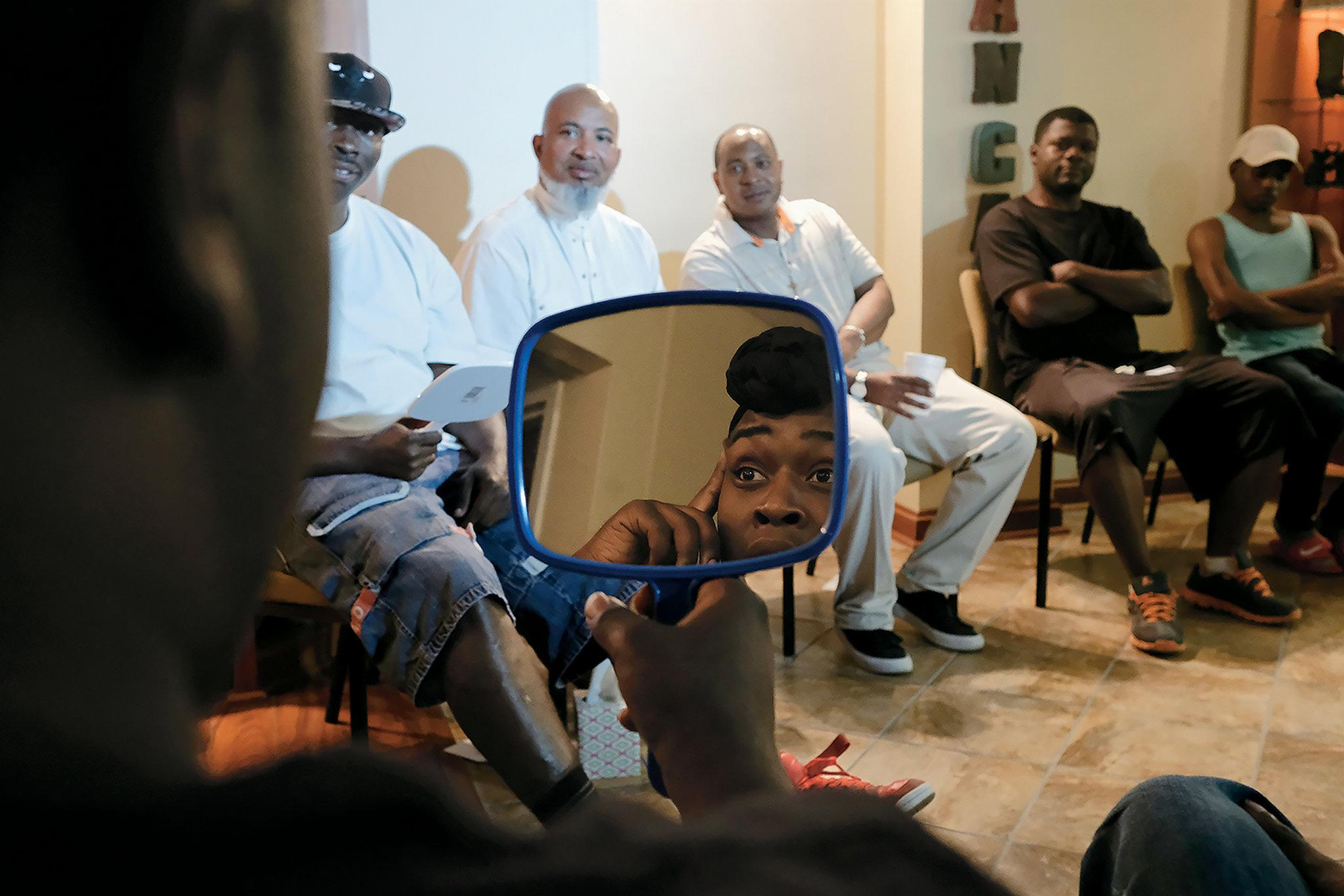 Jennings taking part in Sturdevant's support group in May. Participants were asked to look in the mirror and say something positive about themselves.