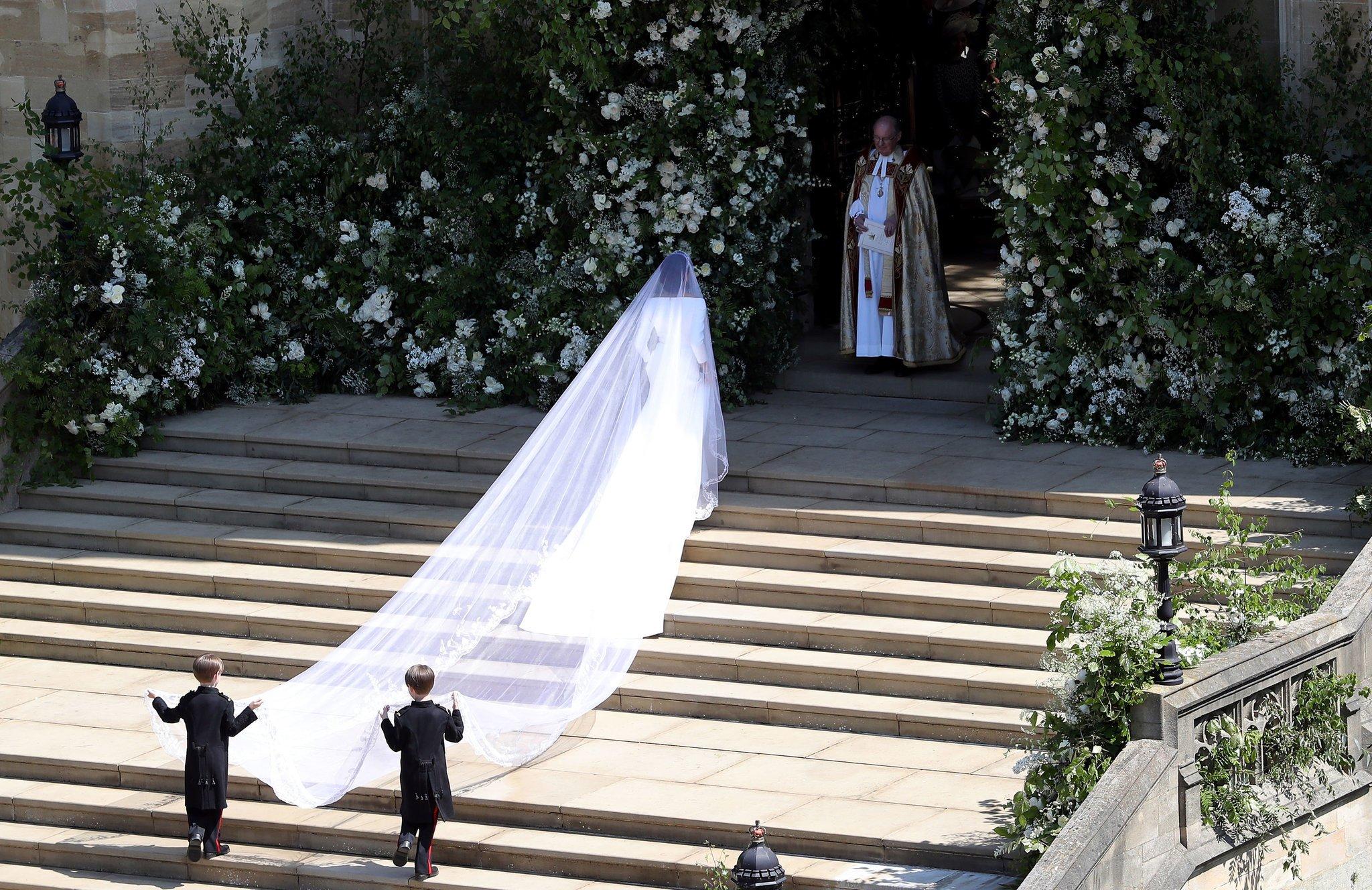 It was the veil, five meters of delicate silk tulle embroidered with flowers representing the 53 countries of the British Commonwealth, Kensington Palace and her home state of California, that carried the weight of history, duty and tradition. It floated out behind, helped along by two little page boys. She wore the veil with Queen Mary's  diamond and platinum bandeau tiara, which had been lent to her by her new grandmother-in-law, Queen Elizabeth II. The tiara, created in 1932, is dominated by a central brooch that dates to 1893.