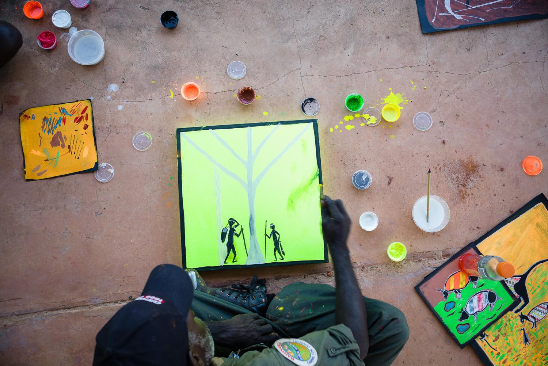 Ranger and artist Greg Wilson making a start on a fluoro masterpiece (photo by Hugo Sharp).