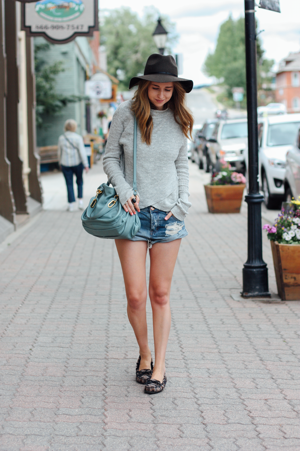 Leadville, Colorado in Free People, One Teaspoon, Minnetonka Moccasins and American Eagle hat.png