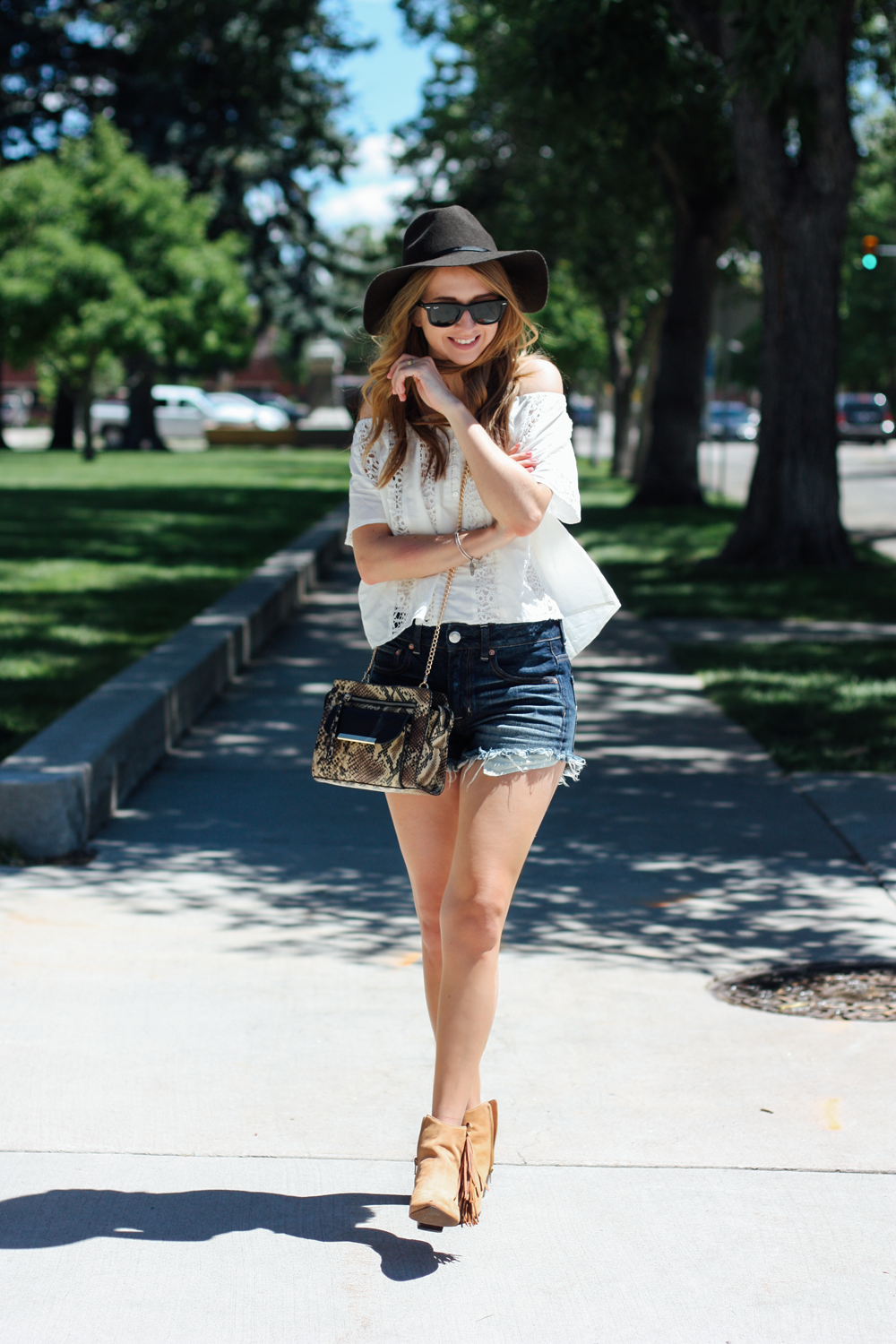 American Eagle hat and denim shorts, Forever 21 off-the-shoulder top, Matisse Footwear Shields booties in Cheyenne, WY via truelane.png