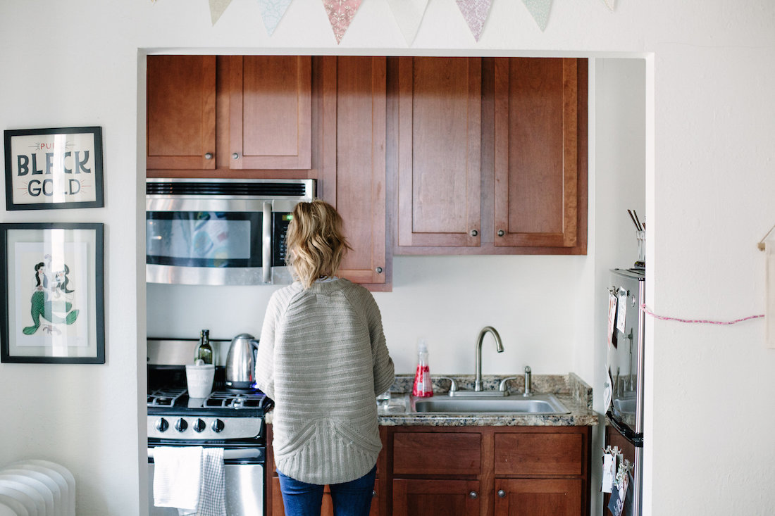 "My kitchen looked nothing like this when I moved in. There was a remodel a year or two ago, and it may be prettier now, but I have basically zero storage and literally nowhere to eat (they took out a bar the length of this whole doorway!) One of those ""charming little quirks"" you learn to live with."
