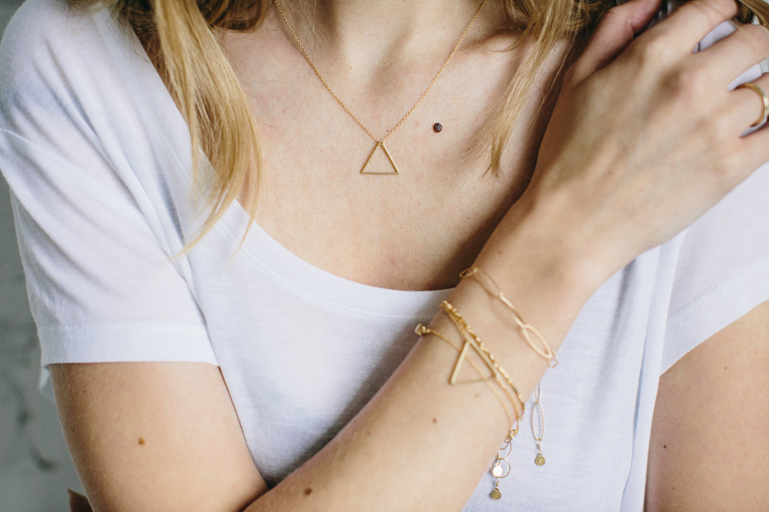 The    Lindbergh necklace   : three nesting triangles that can be added or removed as desired for countless versatile looks.