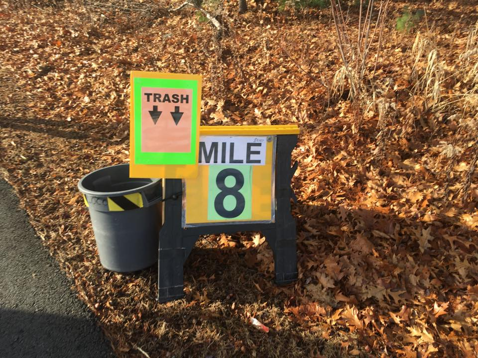 each mile marker had a trash barrel attached to it