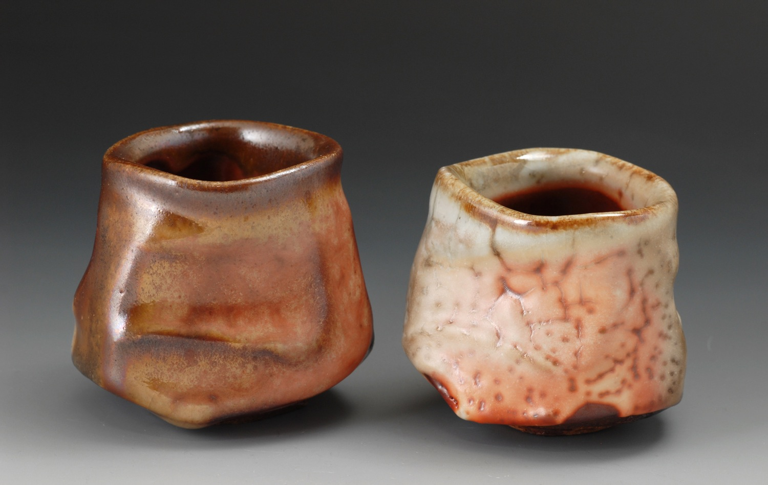 Faceted whiskey cups, shino glaze