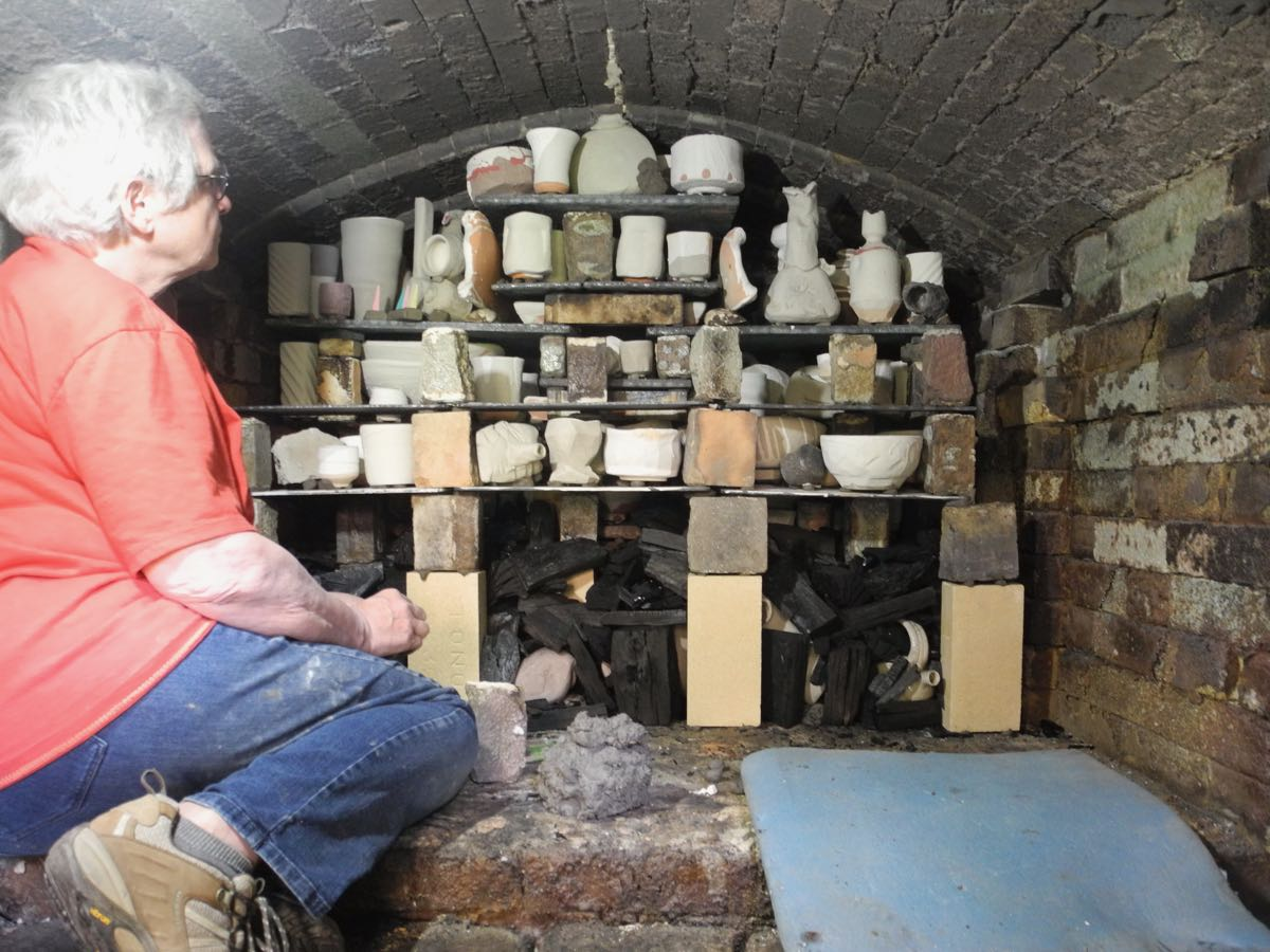 Mary loading the kiln