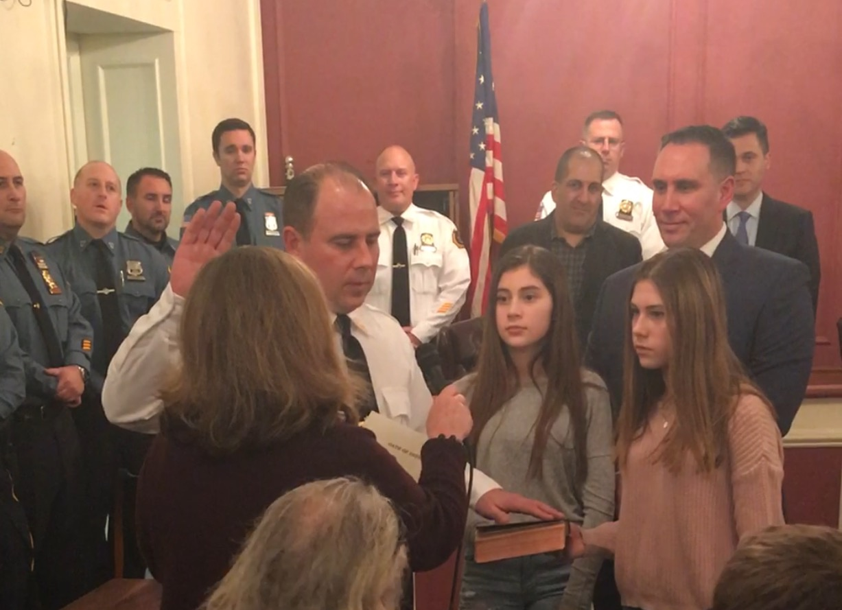 Mayor Dianne Camelo Didio administers the oath of office to our new Police Chief William Wicker. Tuesday, January 24, 2017. Pictured with Chief Wicker are his two daughters (front) and his brother Keith