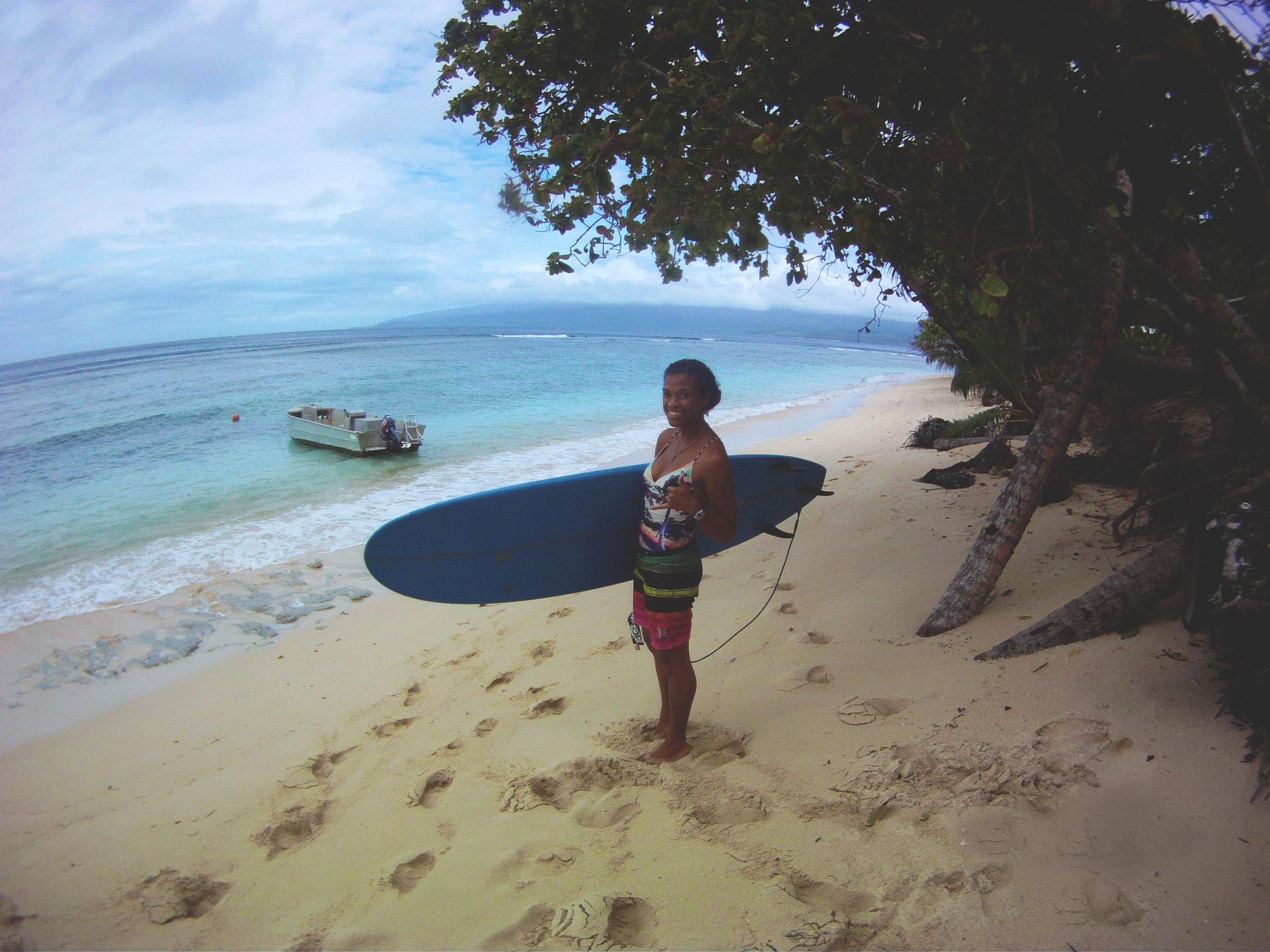 Alise heading to surf
