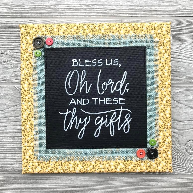 "Bless Us Oh Lord and These Thy Gifts - This is the opening line to the common table prayer spoken by families around the world at mealtime. What a wonderful reminder that all gifts, great and small, come from our loving Father.10""x10"" Handmade ArtworkElements: hand-painted and hand-lettered canvas, colorful burlap, patterned fabric, coordinating buttons, wood frame, claw hangerPrice: $30 (includes US-based shipping)"