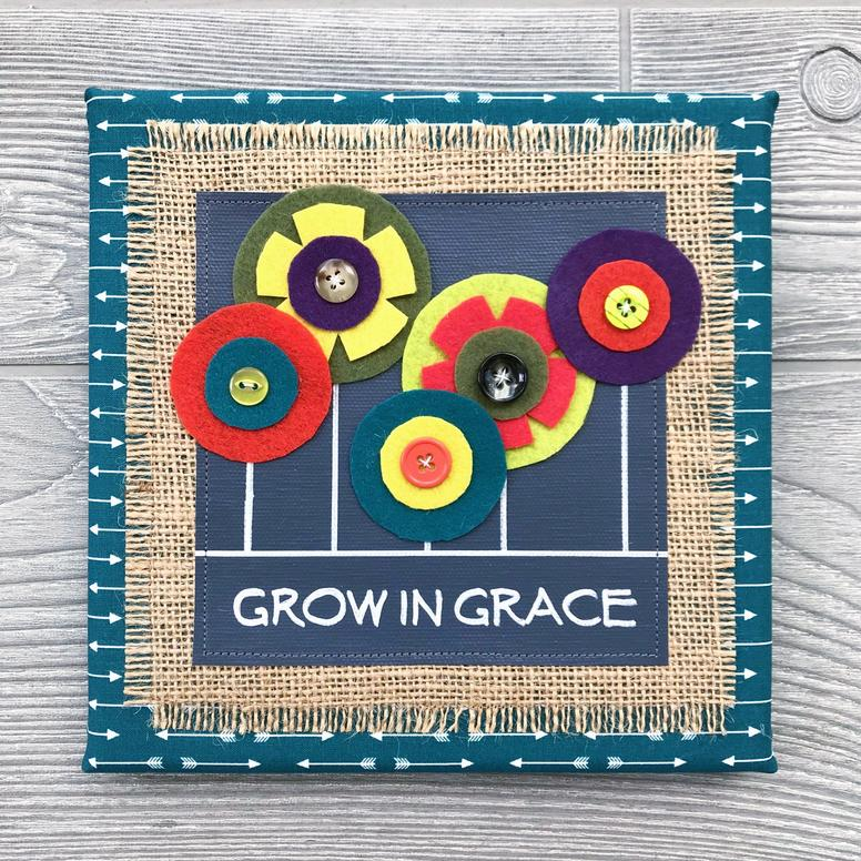 "Grow in Grace - Every piece in our floral collection is handmade with love and one of a kind. We combine hand-lettered canvas and hand-cut felt flowers with colorful fabric, burlap and buttons. This unique artwork is sure to brighten your home and your mood!8""x8"" Handmade Literary ArtworkElements: hand-painted and hand-lettered canvas, colorful burlap, ultra-soft felt, patterned fabric, coordinating buttons, wood frame, claw hangerPrice: $25 (includes US-based shipping)"