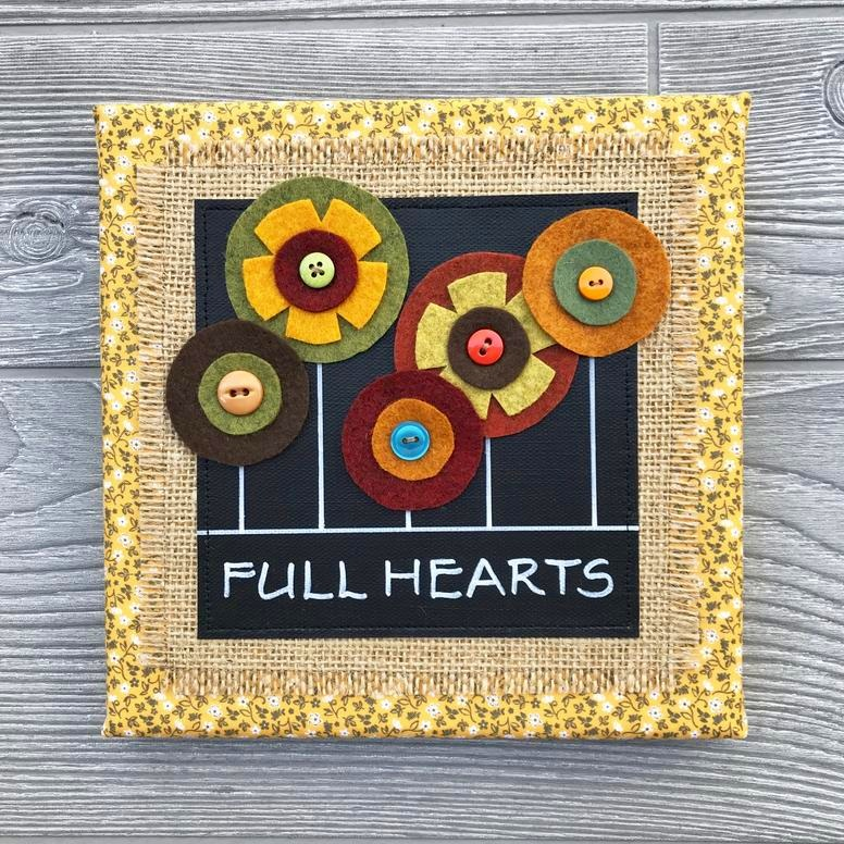 "Full Hearts - Every piece in our floral collection is handmade with love and one of a kind. We combine hand-lettered canvas and hand-cut felt flowers with colorful fabric, burlap and buttons. This unique artwork is sure to brighten your home and your mood!8""x8"" Handmade Literary ArtworkElements: hand-painted and hand-lettered canvas, colorful burlap, ultra-soft felt, patterned fabric, coordinating buttons, wood frame, claw hangerPrice: $25 (includes US-based shipping)"