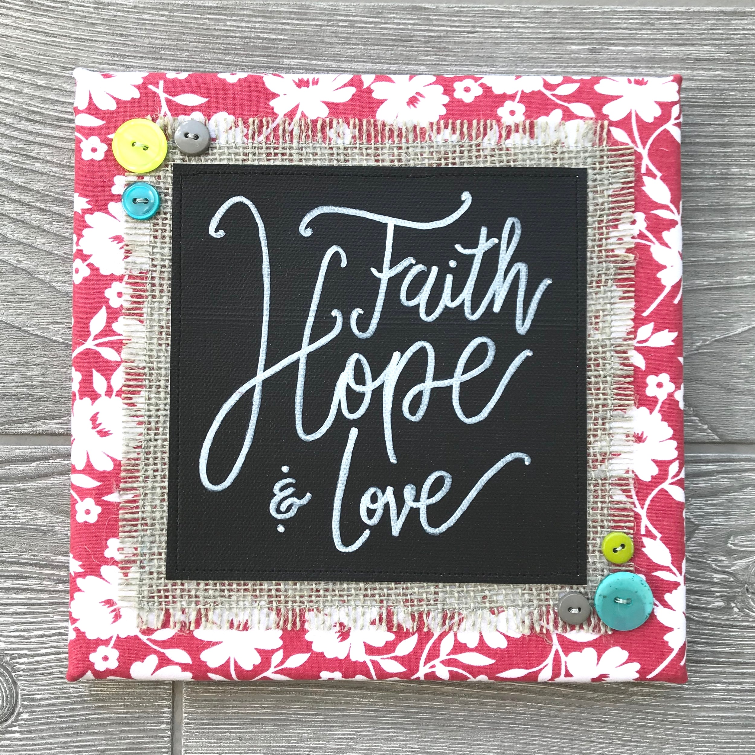 "Faith, Hope & Love - What is the meaning of life? These three words sum it up quite simply: Faith, Hope & Love. ""But the greatest of these is love.""8""x8"" Handmade Literary ArtworkElements: hand-painted and hand-lettered canvas, colorful burlap, patterned fabric, coordinating buttons, wood frame, claw hangerFeatured Scripture: 1 Corinthians 13:13Price: $25 (includes US-based shipping)"