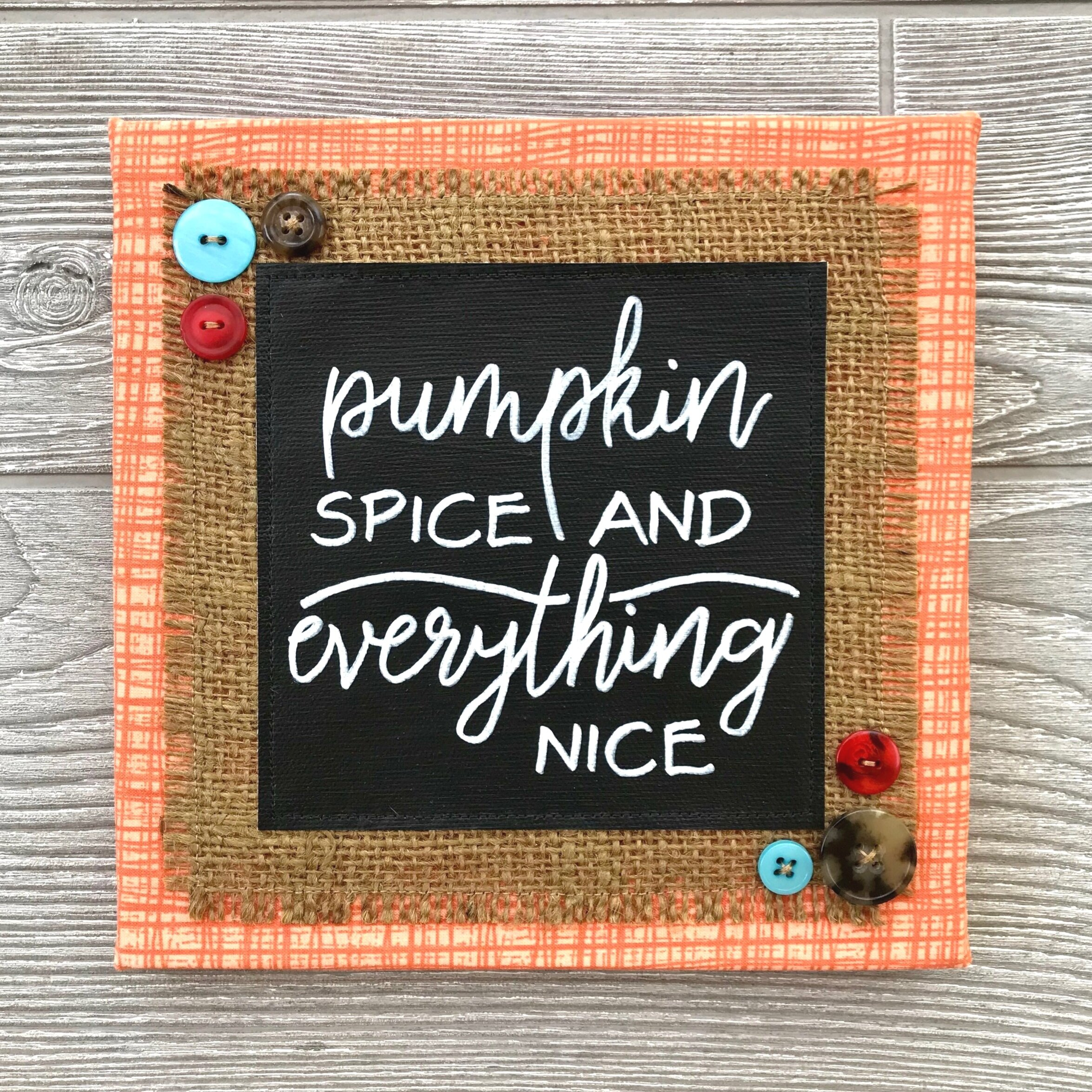 "Pumpkin Spice and Everything Nice - Let the warm and comforting scent of pumpkin pie (or that beloved pumpkin spice latte) dance across your mind. It's a recipe for pure happiness. :) This handcrafted artwork reminds us that the sights and scents of fall are truly the nicest in the world.8""x8"" Handmade Literary ArtworkElements: hand-painted and hand-lettered canvas, colorful burlap, patterned fabric, coordinating buttons, wood frame, claw hangerPrice: $25 (includes US-based shipping)"