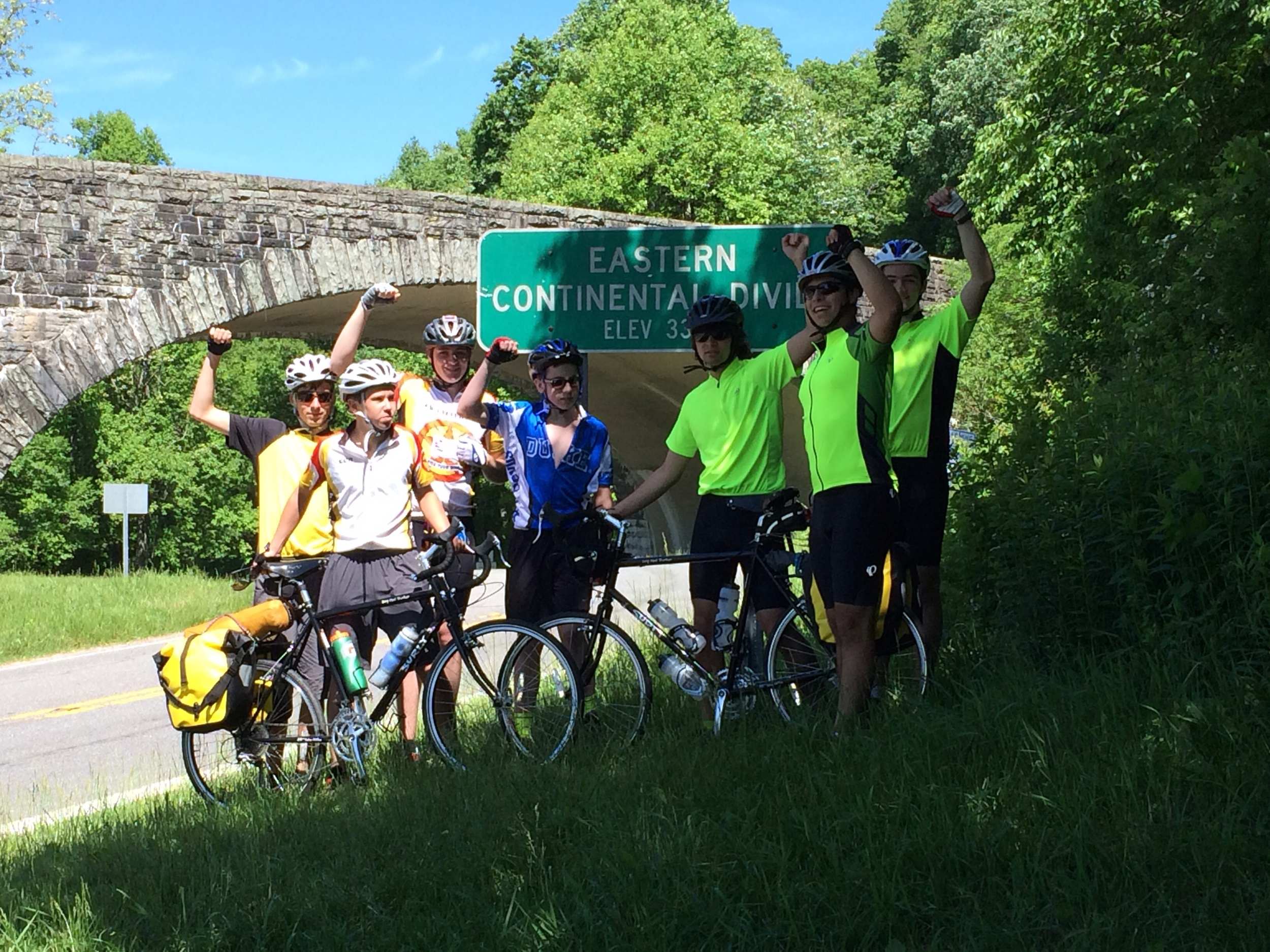 The crew celebrates their arrival to the eastern continental divide.