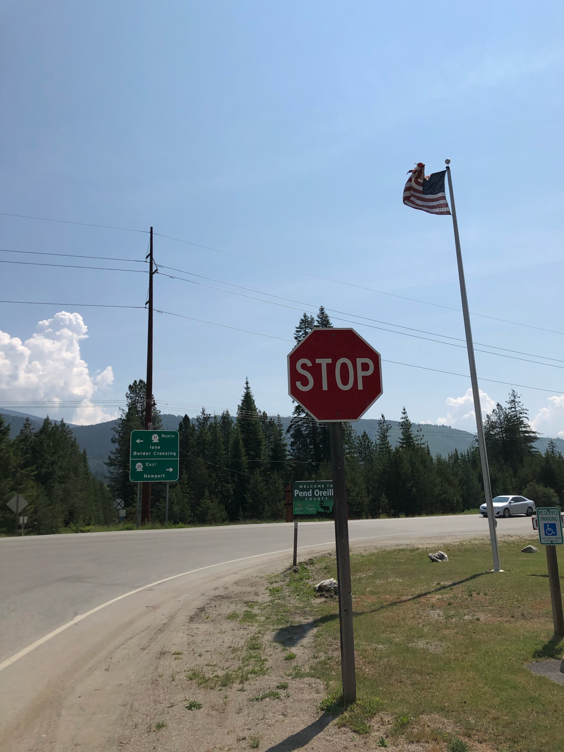 The westward blowing flag in this picture is the real stop sign for an eastbound biker