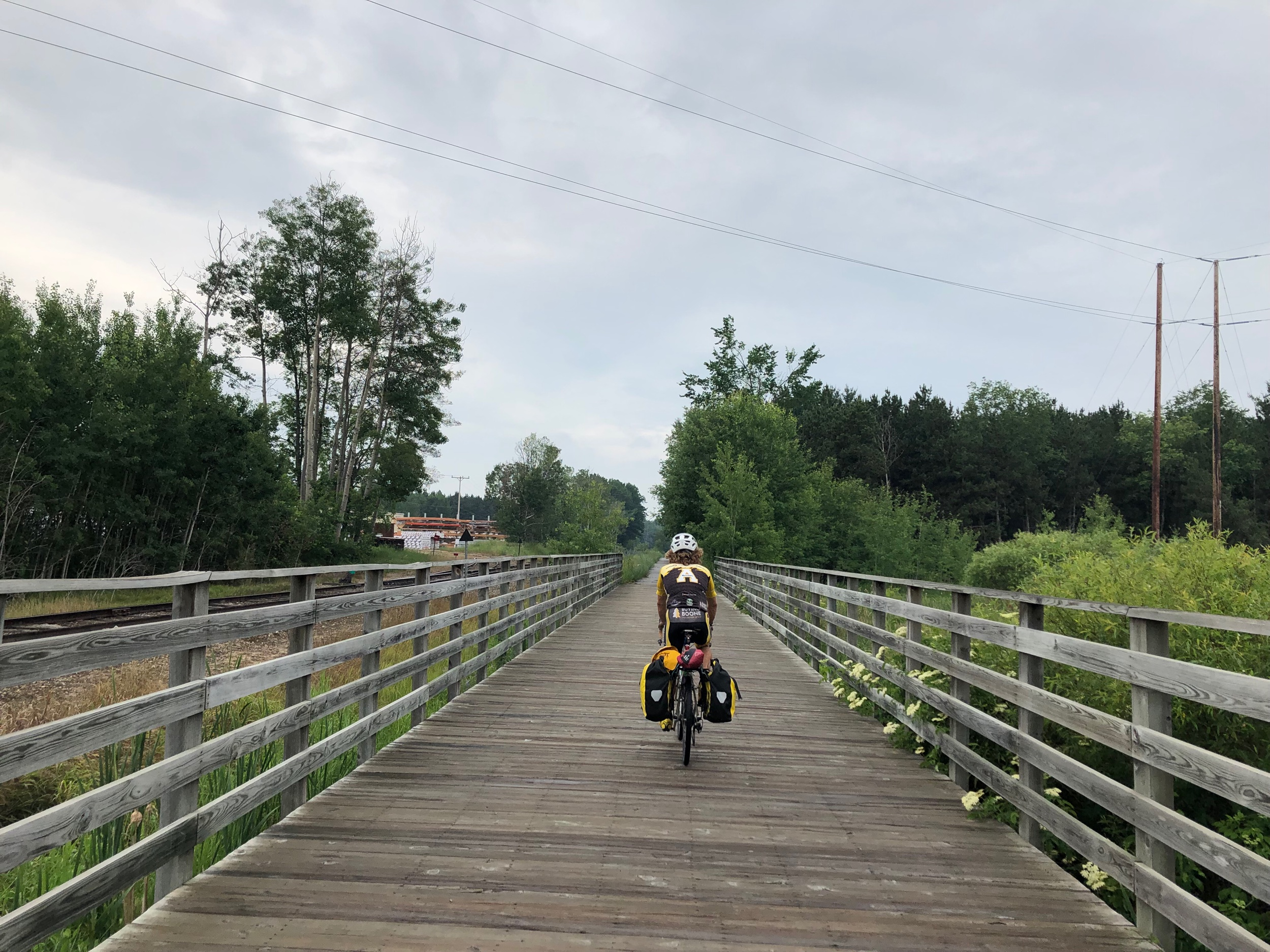 Evan rides a bike trail into Traverse City