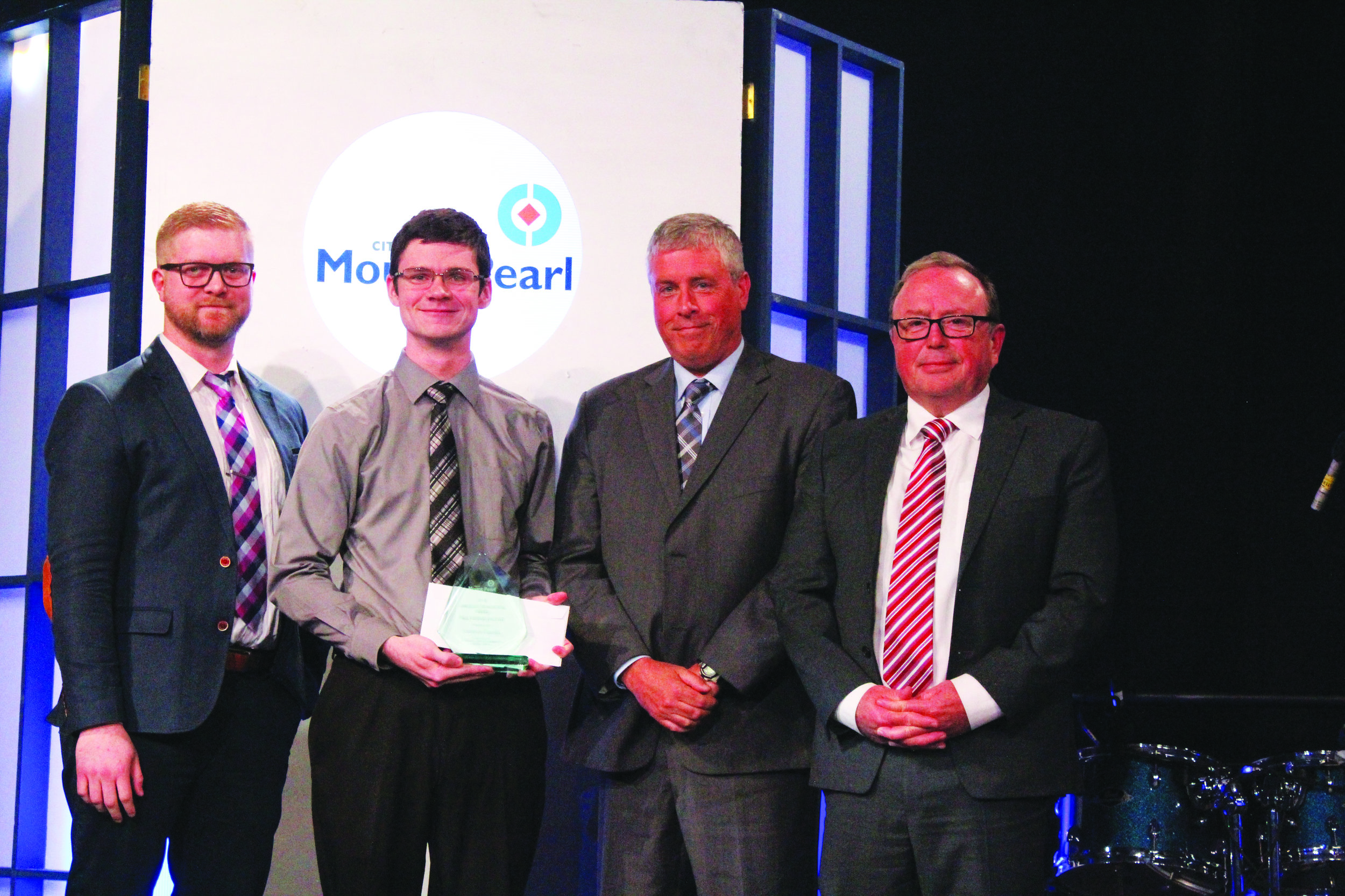 From left: Chris Grimes with Newfoundland and Labrador Credit Union; Male Youth of the Year, Cameron Kinsella; Bill Rossiter; and Mayor Dave Aker.  Mark Squib photo  Mark Squib photo
