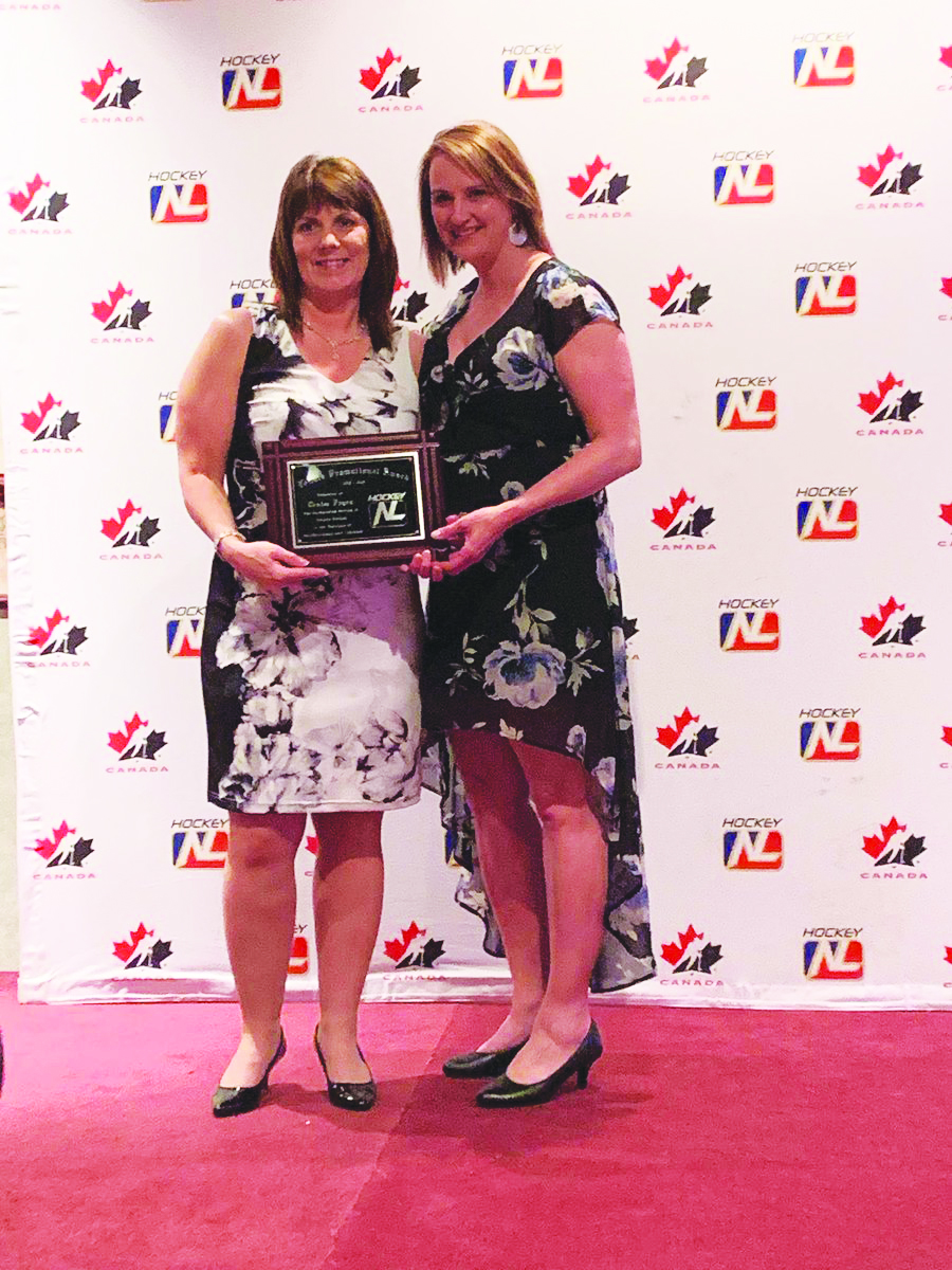 Debbie Bouzane, Chairperson of the Female Council for Hockey NL (right) presents Denise Fagan of Mount Pearl with the Female Hockey Promotion Award at the provincial organization's June banquet.