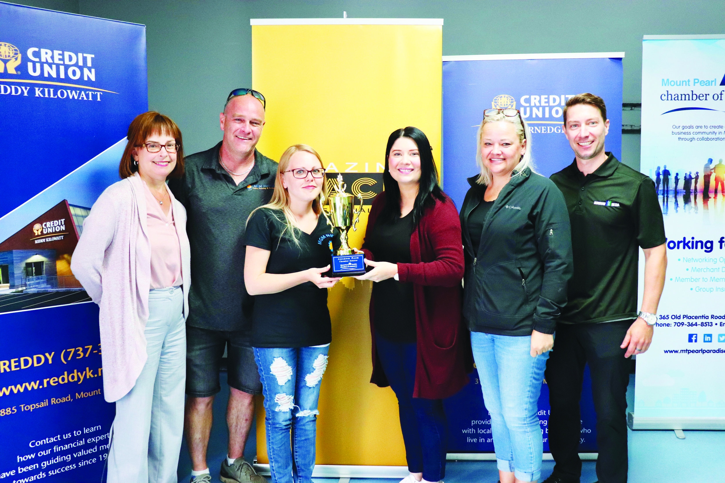 Some of the people who participated in the Mount Pearl – Paradise Chamber of Commerce Amazing Race contest included, from left: Rhonda Goodridge of Reddy Kilowatt Credit Union, winning team members Scott Glynn and Heather Bishop from MGM National Safety and Felicia Ings and Leah Murphy of Get Payroll Solutions, and Chamber of Commerce President Dave Halliday.