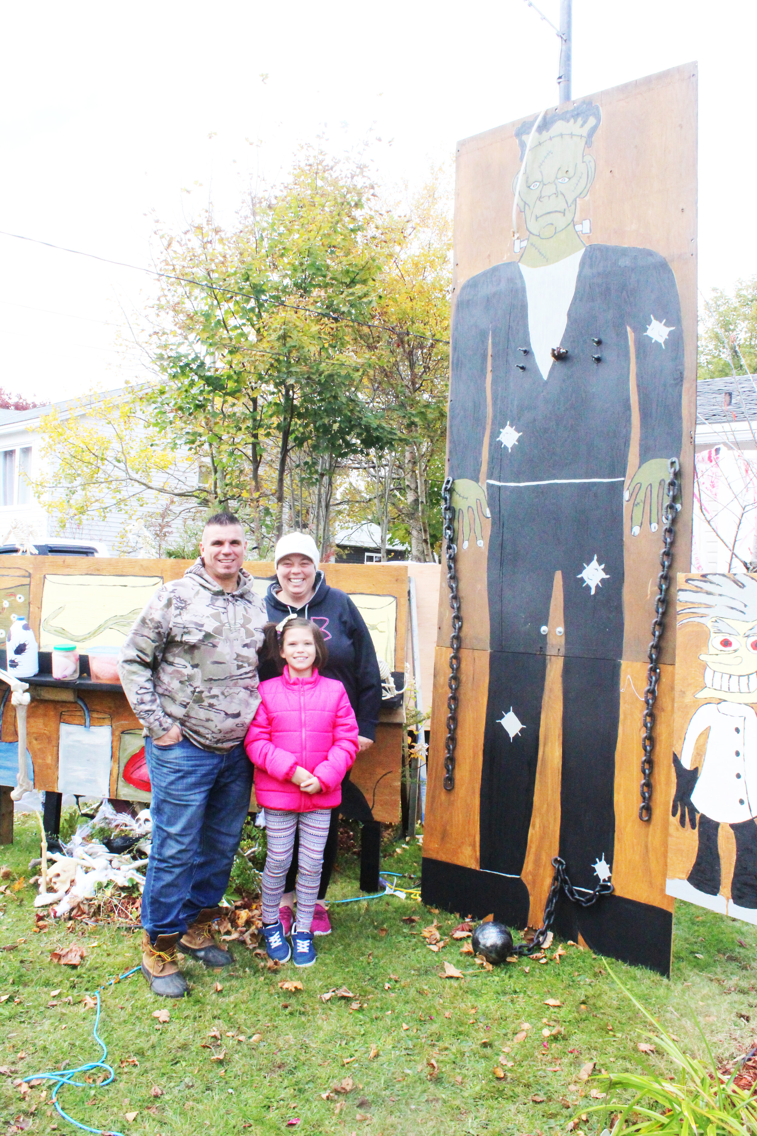 Todd Skiffington, Autumn Skiffington, and Jane Green with a portion of their spectacular Halloween display. Mark Squibb photo