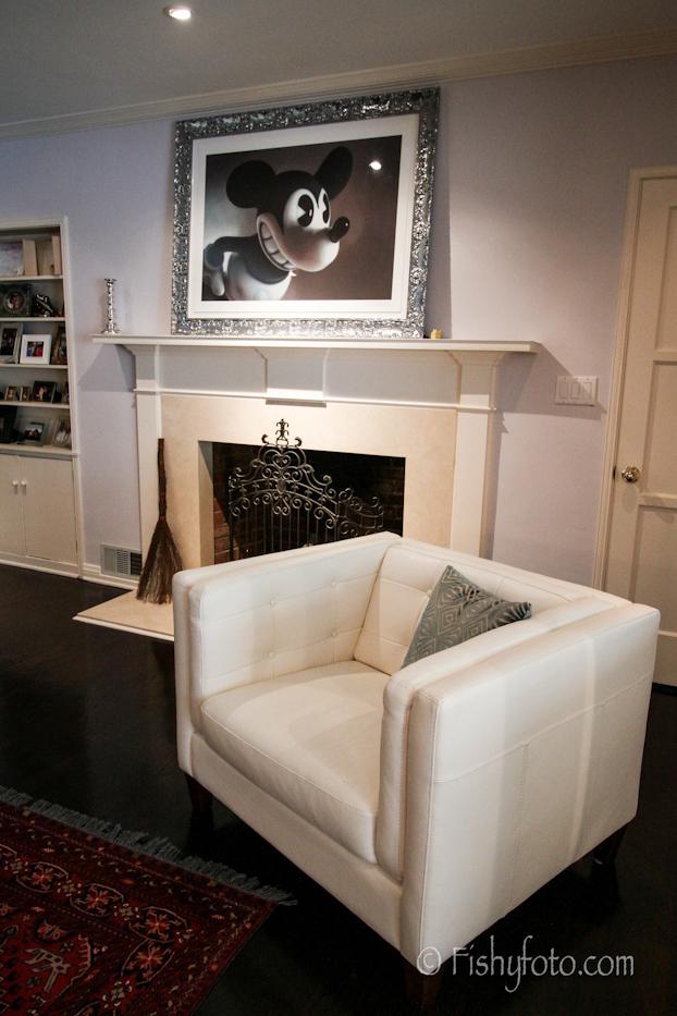 White leather sofa and a Gottfried Helnwein art piece.  #FishyFoto