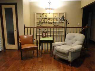 Oversized window, brown chair, side table.jpg