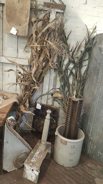 Fall-decorating-with-antique-crocks-and-cornstalks