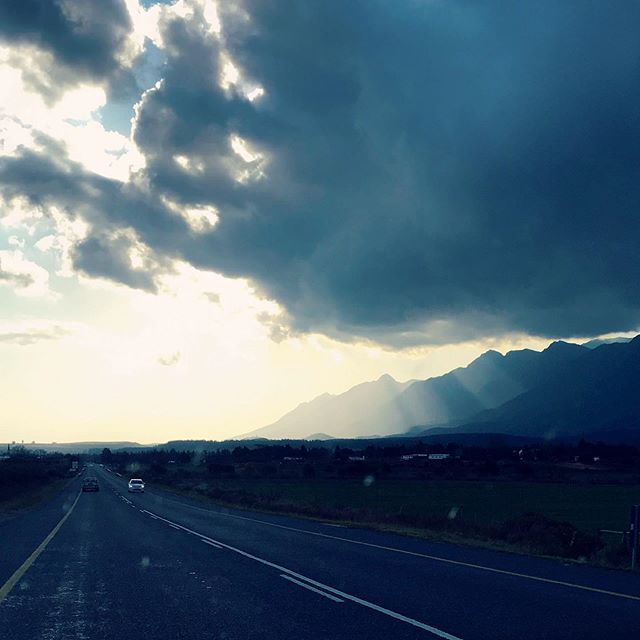 Moody afternoon drive drive home, emerging from a storm into sunlight with good music and the @mitchelleva 🌈🌦🦄 These are a few of my favourite things... #good #bestlife #inspiration #mood #instamood #roadtrips #adventure #sun #mountains #nature #magic #landscape #family #bf #travel
