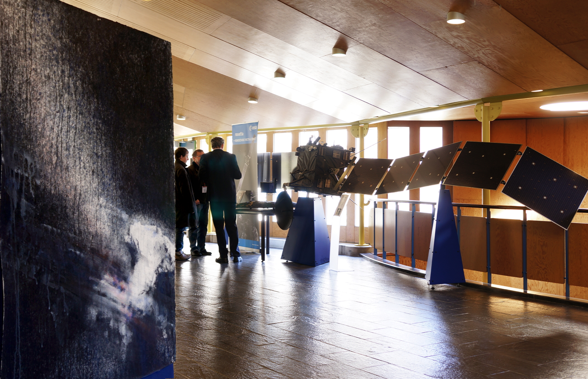 "Solo show at ESA. ""67P I"" painting next to the Rosetta spacecraft model."
