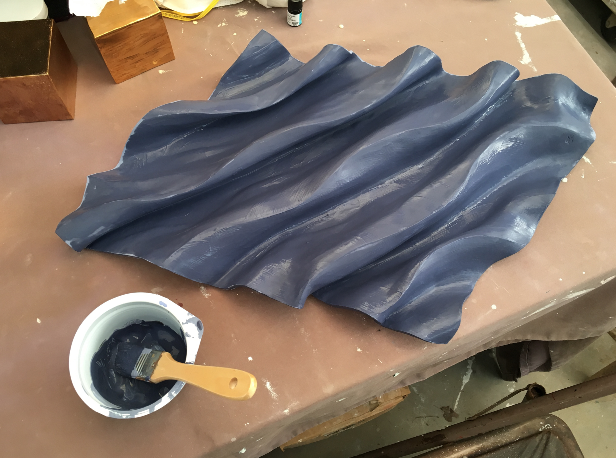 Applying glaze for the 2nd firing.