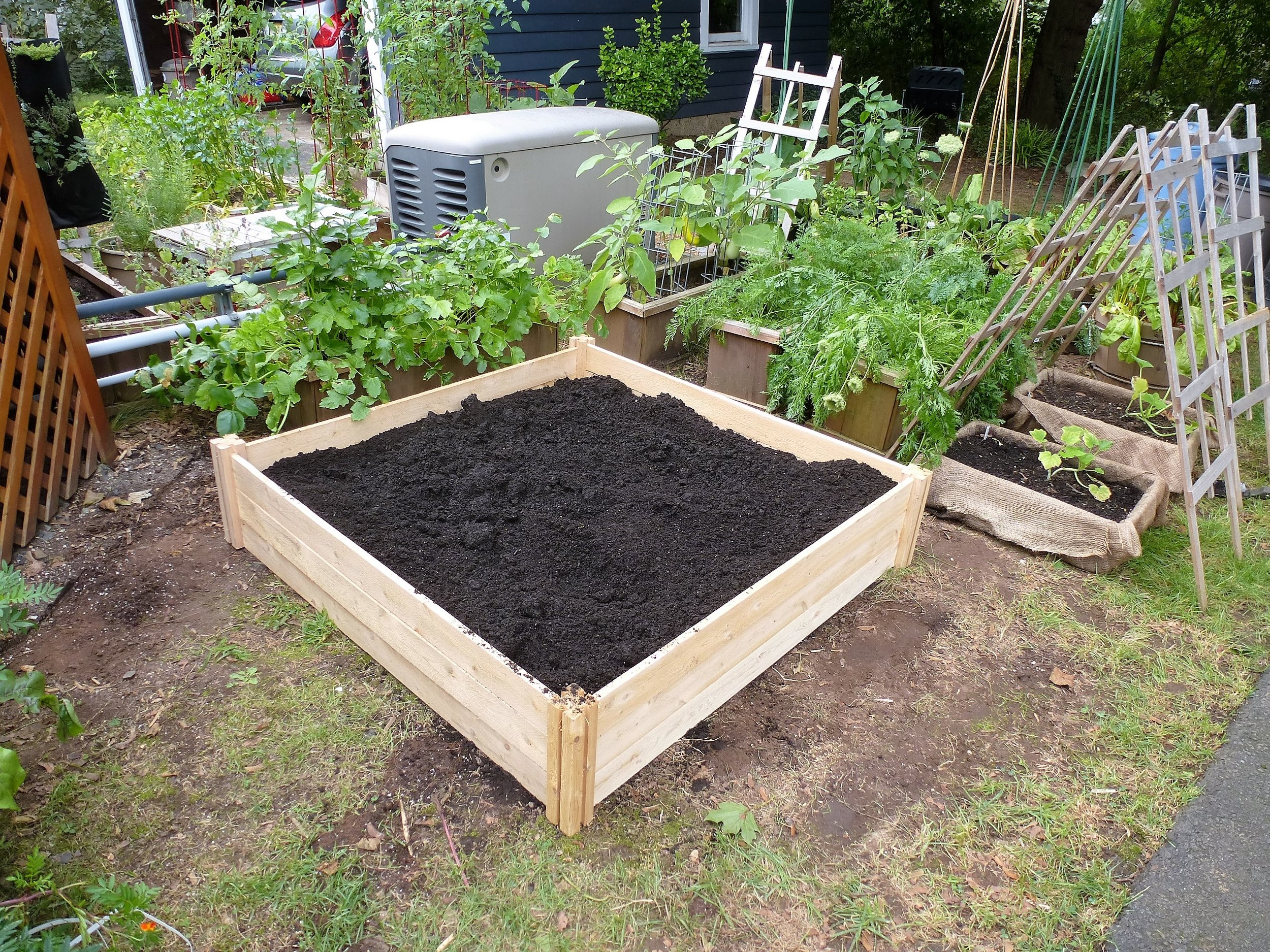 Step 4: Fill with soil and compost.