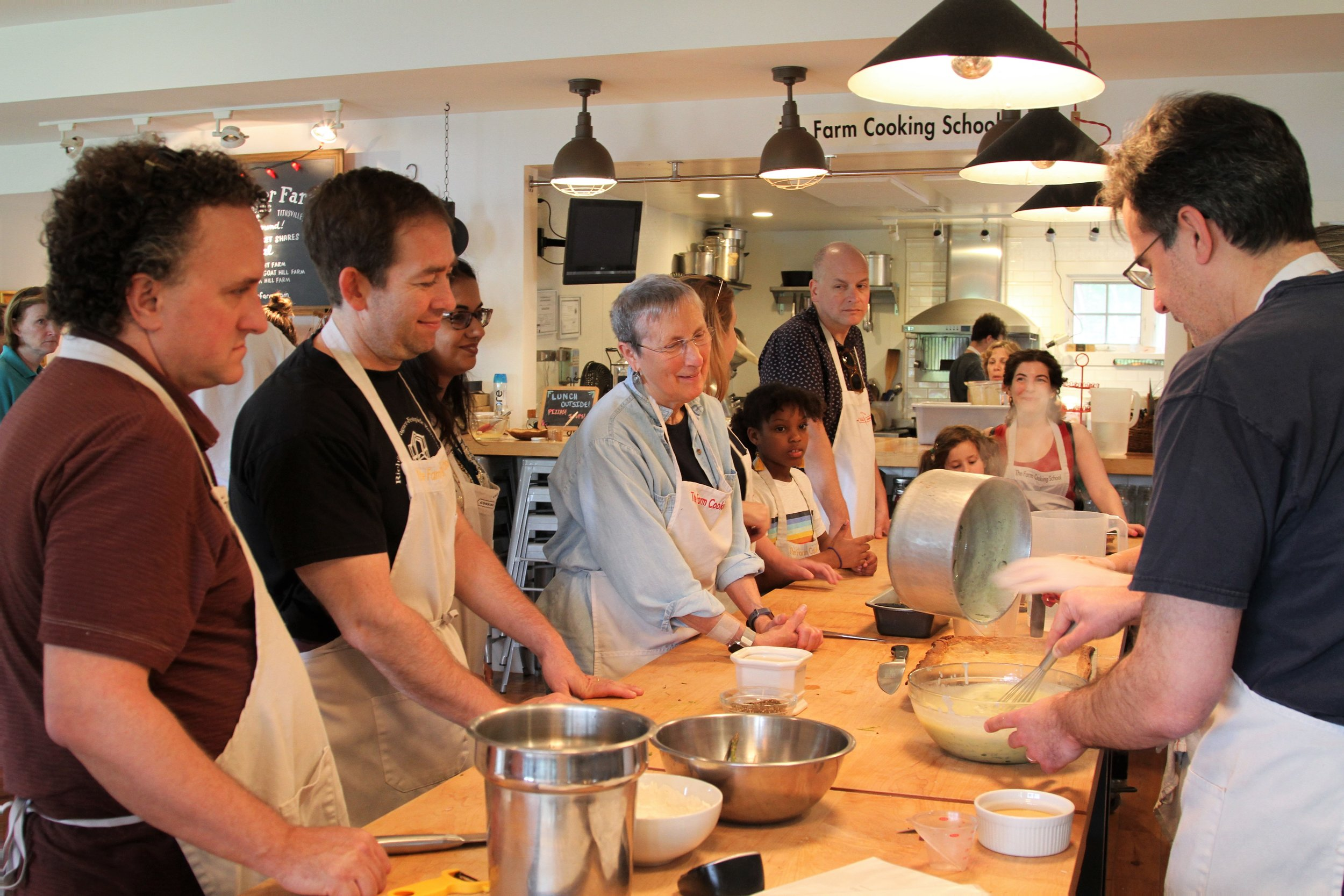 Our group cooking up a storm at The Farm Cooking School Ramps and Asparagus Workshop.
