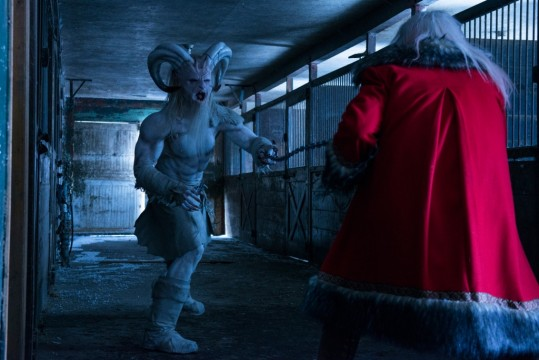 Krampus (left), the evil spirit of Christmas, in a climatic final showdown with Santa Clause.
