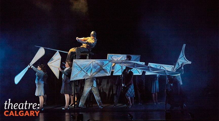 The opening sequence, where the ensemble members create the illusion of a plane in flight is theatrical magic. Photo courtesy of Trudie Lee.