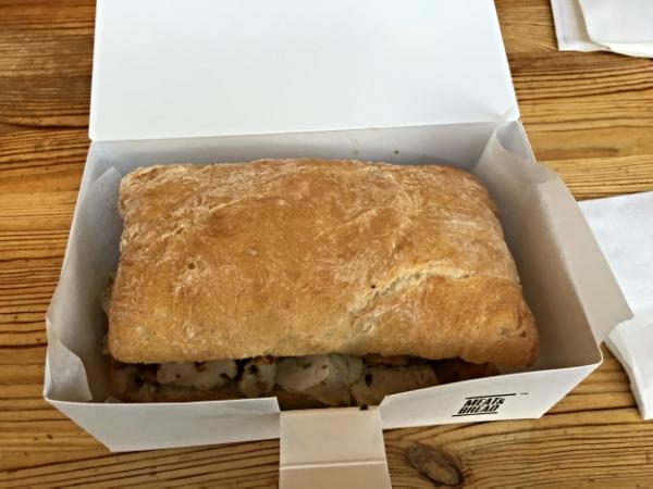Meat & Bread's signature Porchetta sandwich to go.