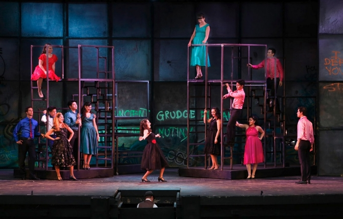 The talented cast (the Sharks are shown here), try to strut their stuff, despite being held down by the efforts of their director and choreographer. Photo credit: Tim Matheson.