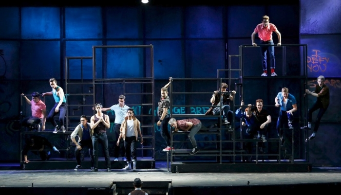 The Sharks and the Jets in Theatre Under The Stars' production of West Side Story. Photo credit: Tim Matheson.