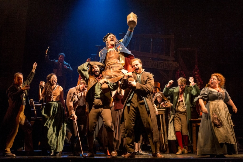 """The company of LES MISÉRABLES performs """"Master of the House"""" with J Anthony Crane as 'Thénardier' and Allison Guinn as 'Madame Thénardier'. Photo credit: Matthew Murphy"""