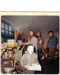 Tim Curtis, Marie Curtis and visitors inside old Sap House, circa 1962
