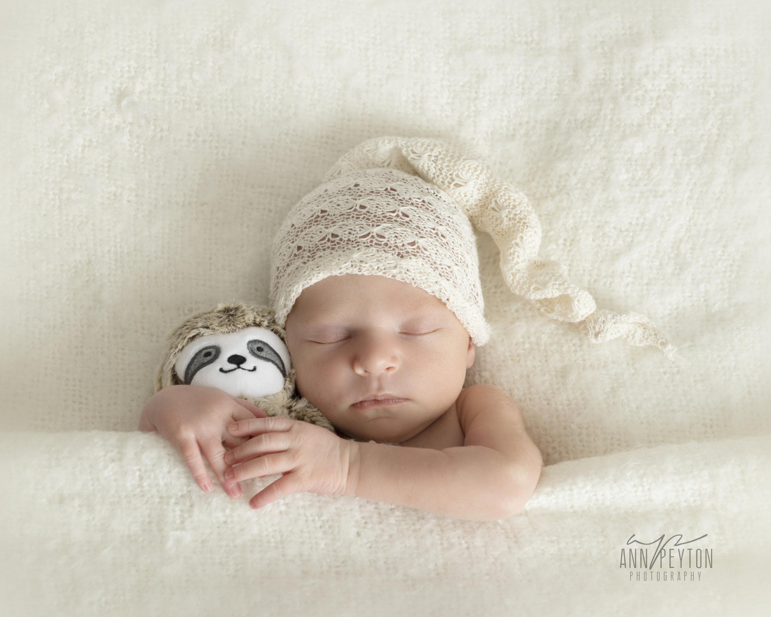 Newborn Hannah with bear