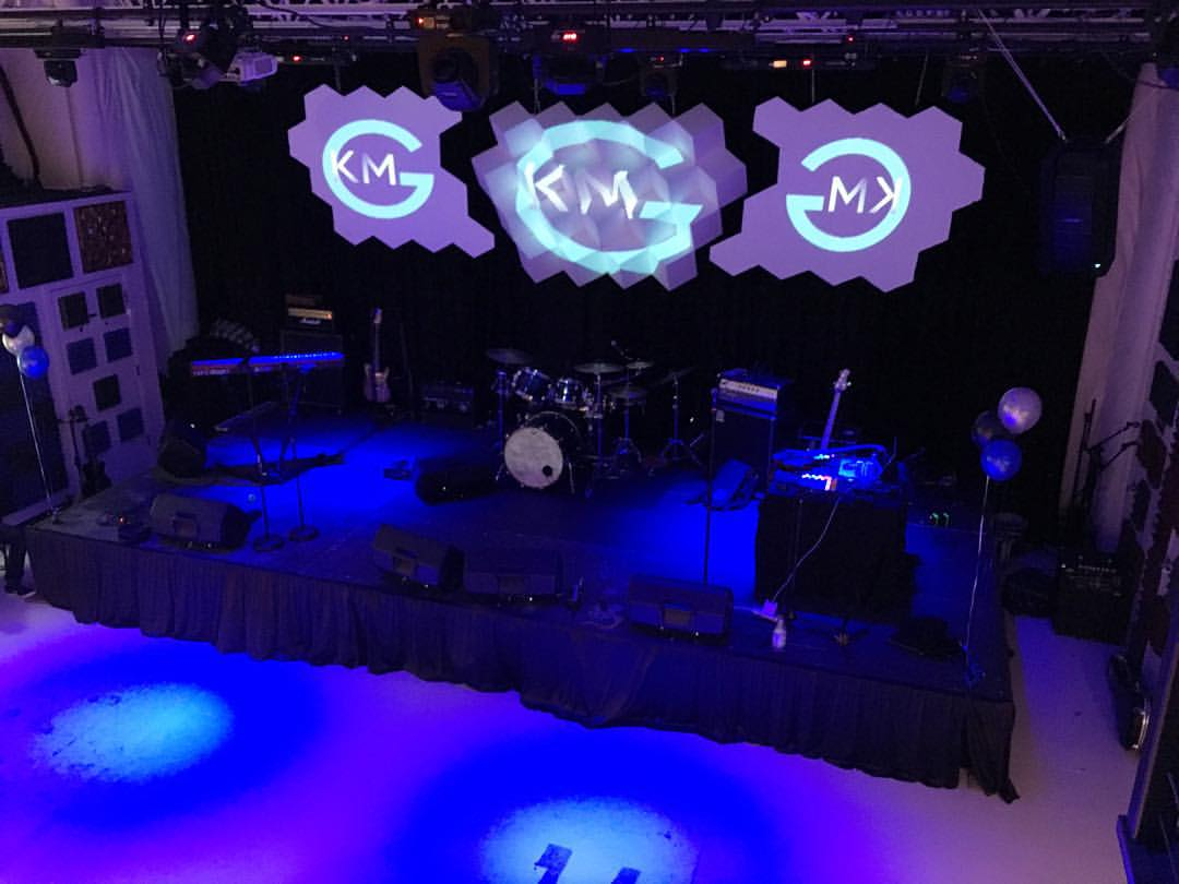 KMG's live-event space and stage view from the VIP balcony area.