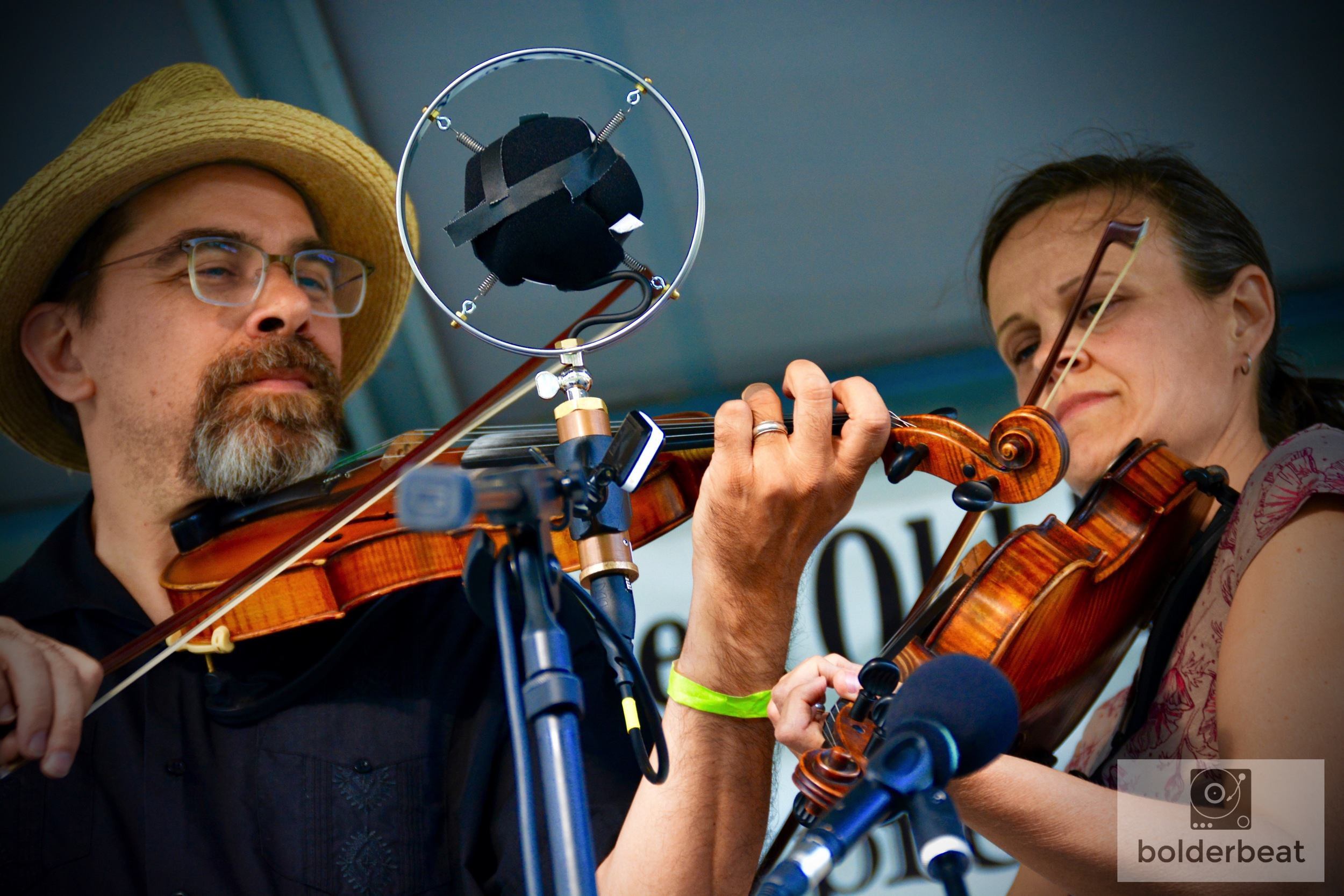 "Tricia Spencer and Howard Rains playing twin fiddles onstage at CROMA Festival. Later, the two hosted a workship titled, ""Backing Up A Fiddle With A Fiddle."""