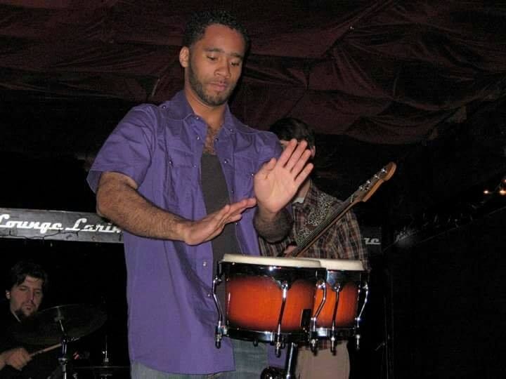 Shane playing drums for his college band in 2009 at Larimer Lounge.