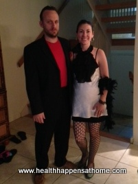 My husband and I all dressed up in costume for the mystery dinner game.